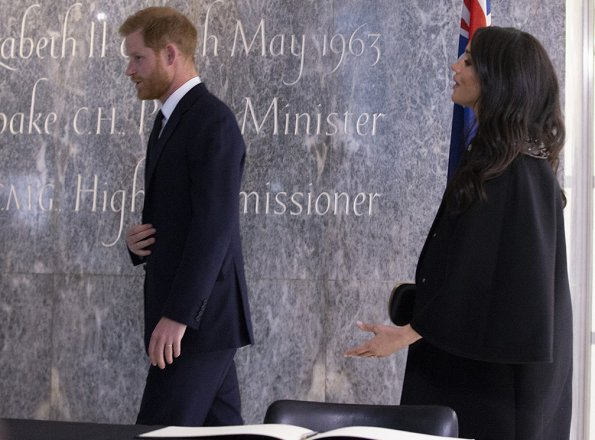 Meghan Markle is wearing custom Gucci coat and shoes by Aquazzura