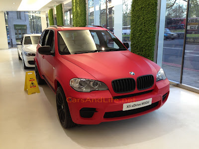Matte Red BMW X M50d with Designer Collection