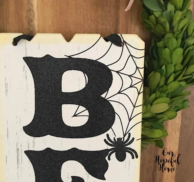 black glitter spider web Beware Halloween sign
