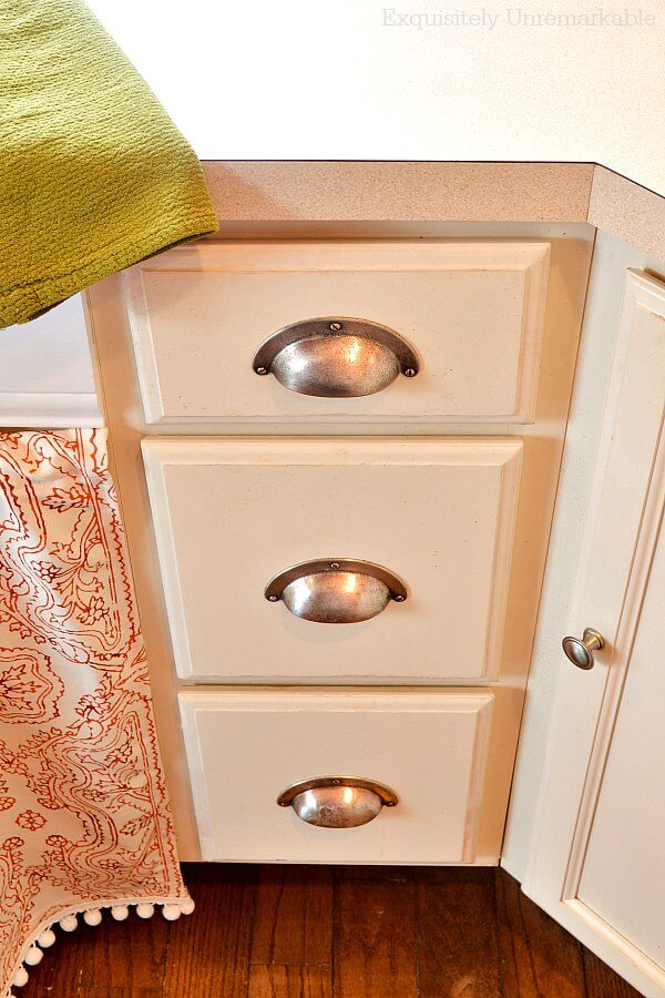 Kitchen Drawers In Bisque With Nickel Toned Farmhouse Pulls