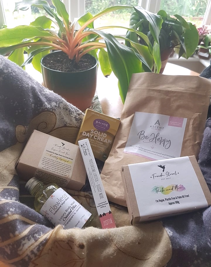 Freedm Street vegan subscription box full of cruelty free plastic free beauty products with green plants in the background