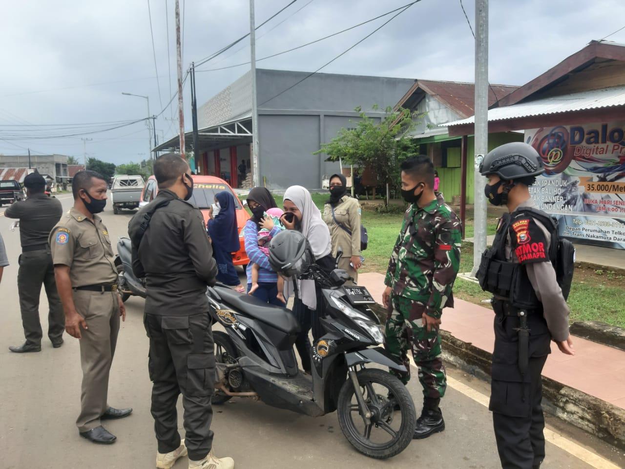 Satgas Yonarmed 9 Lakukan Penertiban Penggunaan Masker di Morotai