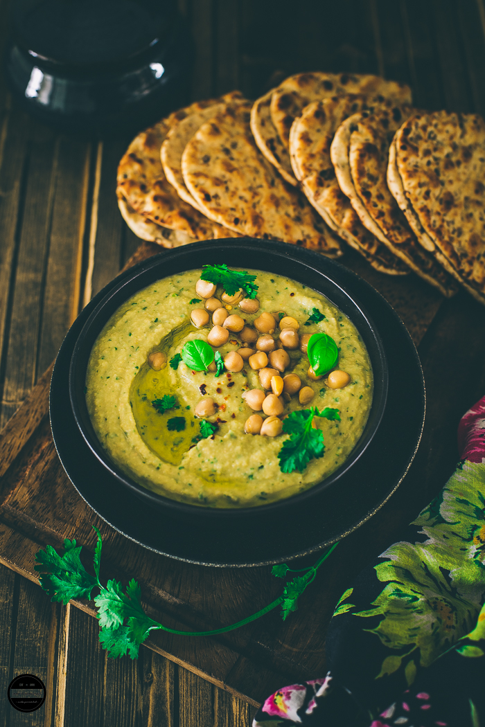 Thai Green Curry Hummus - in this recipe regular hummus is infused with a Thai green curry paste, coconut milk, and basil leaves.Little creamier, sweeter, spicy and tangy at the same time. Great with toasted pitta bread, crackers or vegetable crudites.