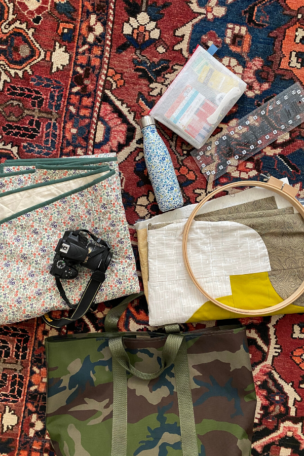 Broadcloth Studio's travel bag contents scattered on the floor | What's in Your Sewing Bag? | Shannon Fraser Designs #quilters #sewingbag #sewingkit #travelbag