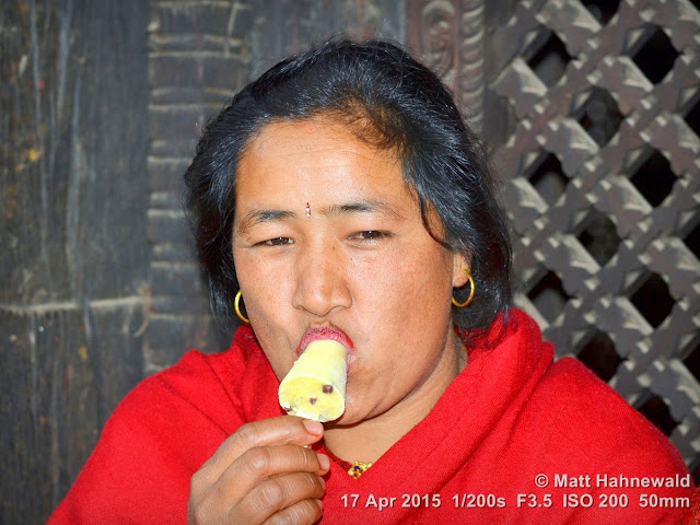 © Matt Hahnewald, Facing the World, close up, street portrait, Bhaktapur, Nepal, Nepali lady, mature lady, ice cream, temptation, fun, symbol, travel, ice-cream bar, licking, mouth