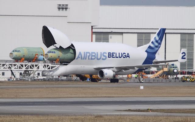 A300-600 ST Beluga Unloads Airbus A320