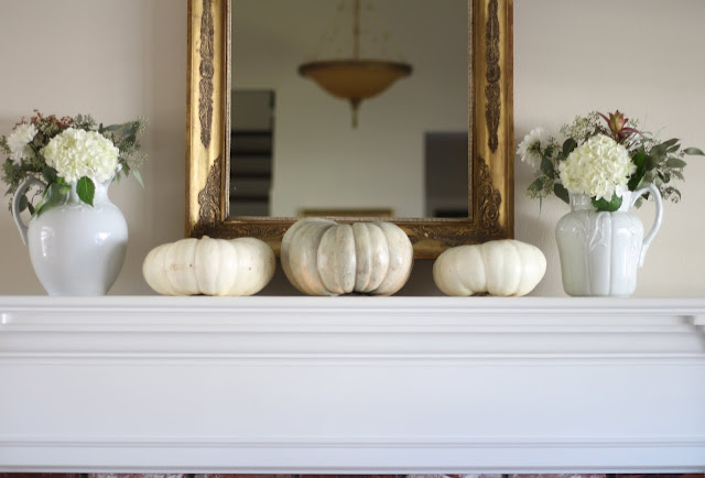 neutral fall decor mantel decorating with white pumpkins and hydrangeas