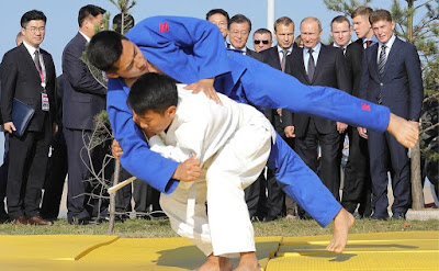 Vladimir Putin and President of the Republic of Korea Moon Jae-in watch a demonstration performance by a youth judo team from the Sakhalin Region.