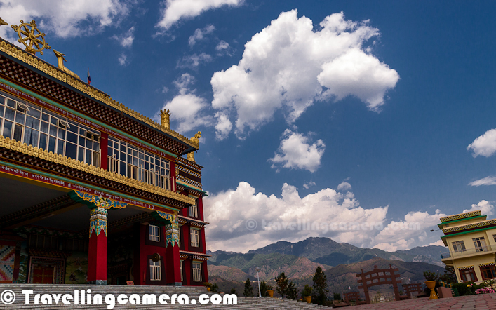 Here is a view when we moved back to look at the temple - Temple on left with main gate in the frame and clouds covering front hills of Jogindernagar ...   Dzongsar Khyentse Rinpoche Institute is administered by Khenpo Kunga Wangchuk until his passing in 2008. Khenpo Jamyang Lösel is the new abbot, together with a faculty of ten khenpos. The student body is composed of over 500 monks from various locales and monasteries, representing all schools of Tibetan Buddhism. The curriculum encompasses a complete theoretical education in Buddhist Philosophy over nine years of study (for a Shastri degree) or eleven years of study (for an Archarya degree). Graduates may pursue further studies and responsibilities and become teachers or khenpos. Many Dzongsar graduates are now teaching the teachers of tomorrow, ensuring that the lineage of the Buddha remains unbroken.