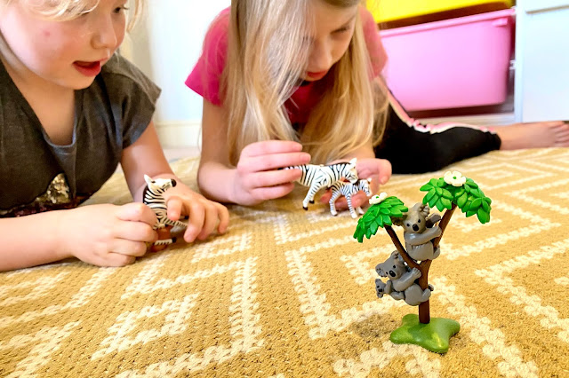 The Playmobil Koala set in the foreground with the playmobil zebra's being played with in the background
