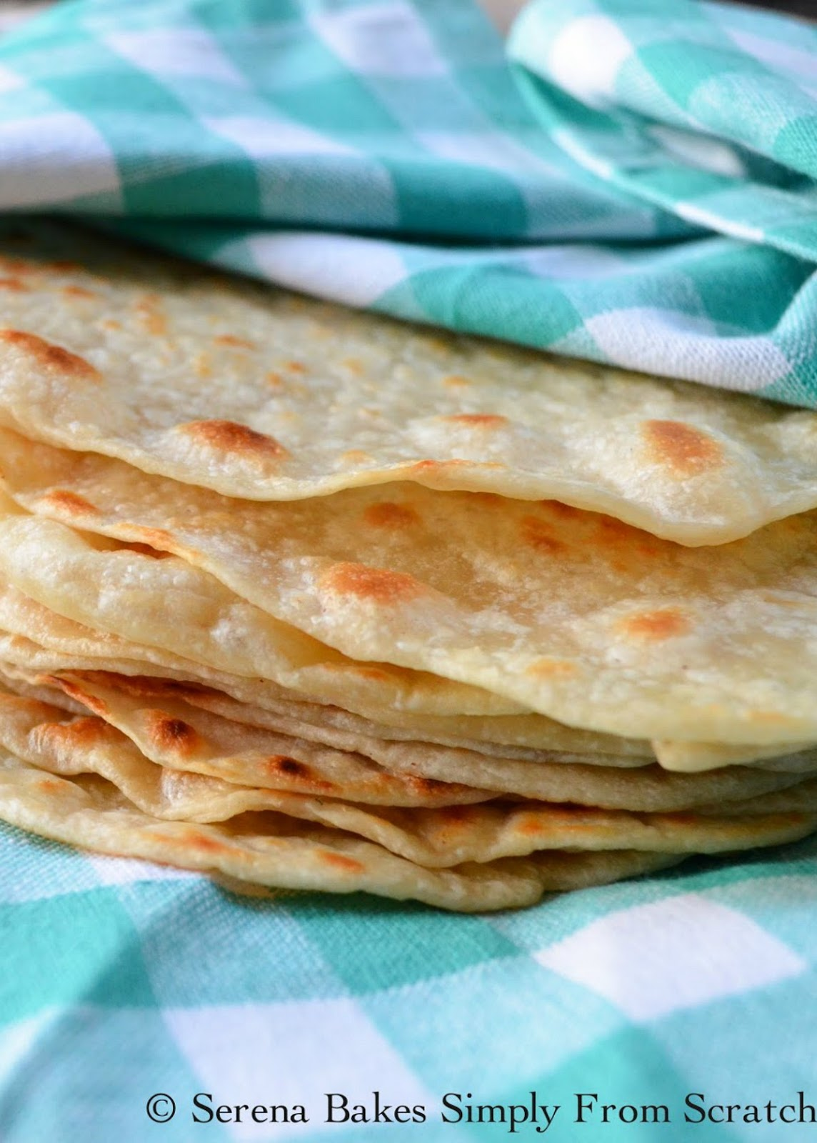 Soft Homemade Flour Tortillas made with butter are absolutely delicious. Soft and tender Flour Tortillas are a favorite for your next Mexican food night. The absolute best Tortillas from scratch. Serena Bakes Simply from Scratch.