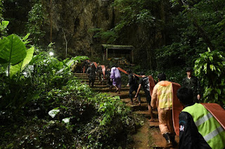 Searchers nearing deep cave chamber