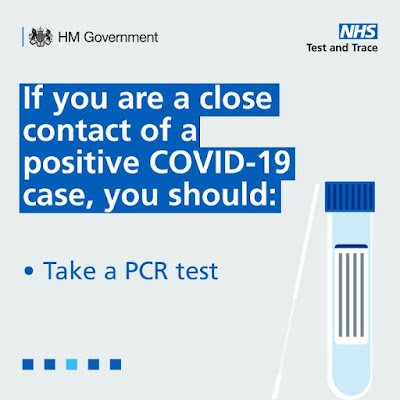 Close contacts should take a PCR test text and image of hand holding phone