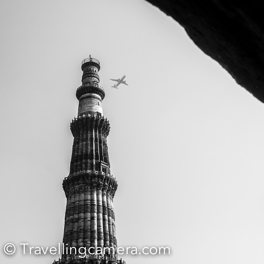Qutub Minar is one of the most popular heritage compounds in Delhi and quite popular destination amongst tourists visiting Delhi. It's also a good places for local folks to spend quality time with their family & friends. Many times photographers and heritage explorers can be seen around Qutub Minar campus. This Photo Journey shares some of the special photographs from Qutub Minar campus. Reaching Qutub Minar has become pretty easy now. One can take Metro to Qutub Minar. The Qutub Minar Metro station is not close to the compound, but there are autos which drop folks from Metro to Qutub Minar and charge 10 rs each. If you don't want to share the auto, most of the folks use meters and that's reliable. It will not cost more than 30 Rs.Other good to way explore these beautiful monuments in Delhi are HOHO buses run by Delhi Tourism department. You can buy a daily pass and hop on/off to/from these buses at defined stations, which are usually very well located around the most popular tourist destinations in Delhi.Booking a Taxi to go to Qutub Minar from Central Delhi, East Delhi or Noida might be a bad idea because of slow traffic movement. I had gone through such experience twice and now try to use Metro, if possible.After Red Fort, Qutub Minar is most visited monuments in Delhi and one should expect lot of people inside Qutub Minar compound, even on weekdays. Apart from the main minaret, there are various architectural structures in this compound  having different stories associated. There are no guides around Qutub Minar now, but you can get an audio device on rent which will keep telling you about the place. Easy to use device and have good details about various spots in Qutub Minar campus.As you walk around this huge compound, you get to see spectacular beauty of the Qutub Minar from different angles. Above photograph shows one of the views of Qutub Minar through the other structures around.It's a wonderful place for photographers because of diversified opportunities to click architecture, people, landscapes and lot more. I have been part of various photo-walks here and every time it was different experience.Tourists from different parts of the world come to Qutub Minar to witness it's grandness and know about it's history. It's really strange that we don't care much to know our own history, but things have been changing for good. There are lot of social circles which inspire folks to visit such places and know more about our heritage. Mehrauli Archeological park  is another interesting place around Qutub Minar.  It's awesome to see these airplanes crossing through Qutub Minar. Although there is a huge different between the top most peak of Qutub and the flight, but such views look dramatic.Qutub is the 2nd tallest minar (73 metres) in India after Fateh Burj. Qutb Minar originally is a UNESCO World Heritage Site which is made of red sandstone and marble. The stairs of the tower has 379 steps, is 72.5 metres high, and has a base diameter of 14.3 metres, which narrows to 2.7 metres at the top. Construction was started in 1192 by Qutb-ud-din Aibakand was carried on by his successor, Iltutmish. Check out more about Qutub on Wikipedia  His expressions explain it all about the height and grandness of Qutub Minar.