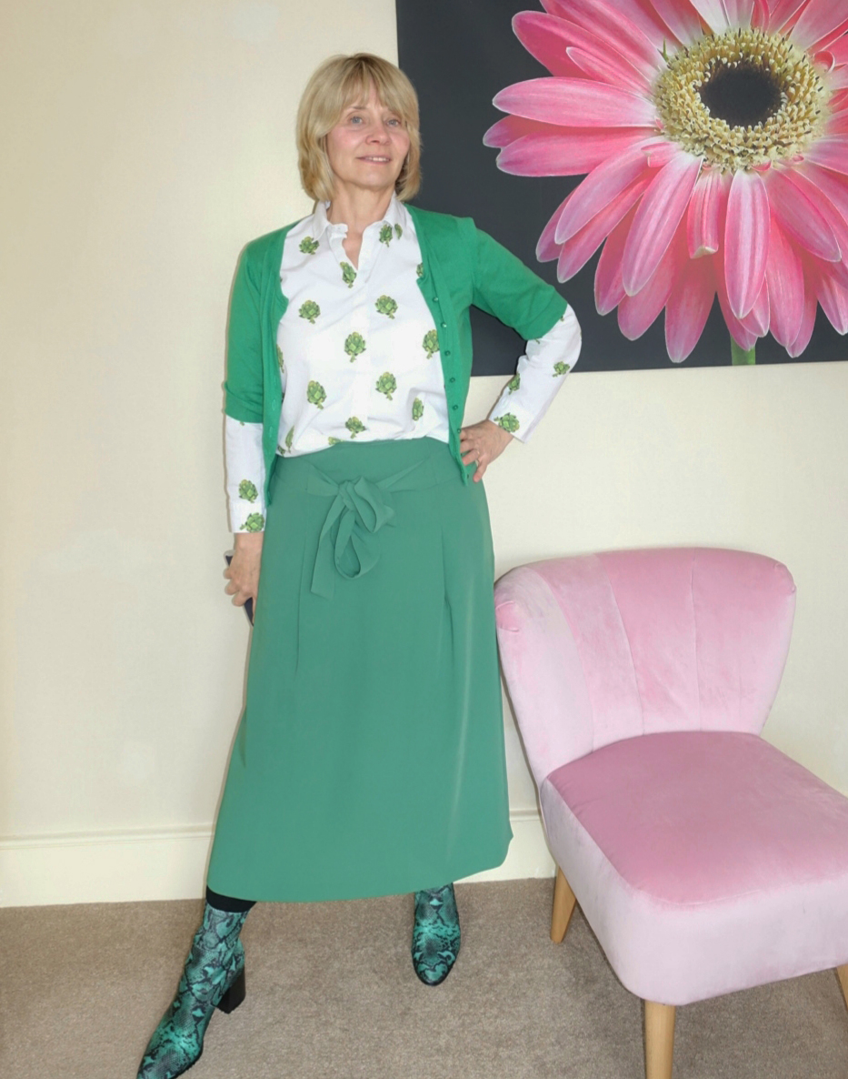 Green midi skirt with green neoprene snakeskin ankle boots and blouse with artichokes print