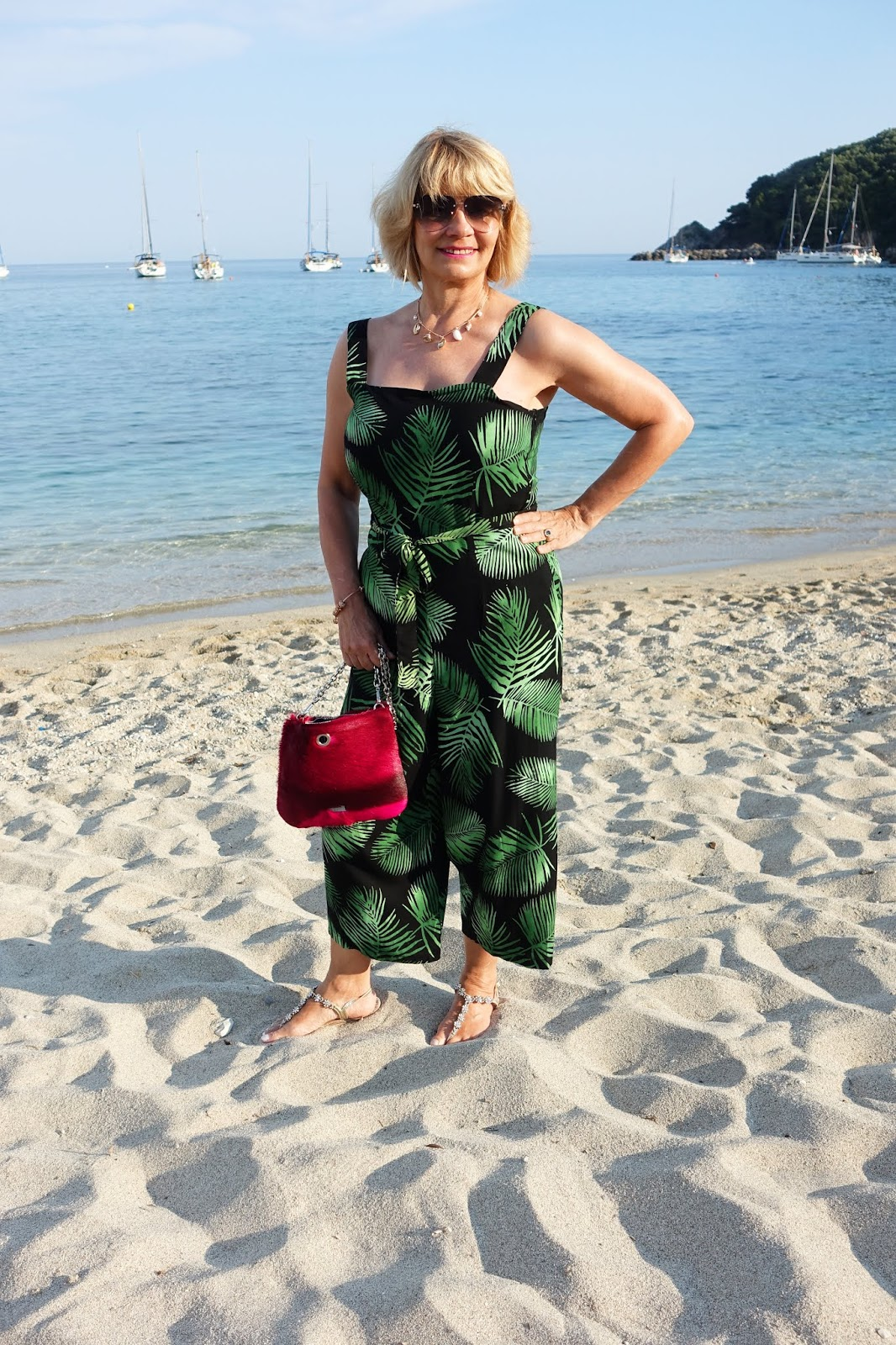Gail Hanlon from Is This Mutton on Voltas beach in Parga wearing batik print cropped jumpsuit from Sugarhill Boutique