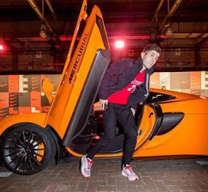 Picture of Devyn's brother Christian Pulisic coming out of a classic car