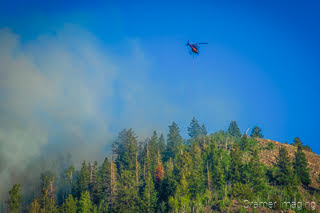 Cramer Imaging's landscape photograph of a helicopter fighting a wildfire near Panguitch Lake Utah