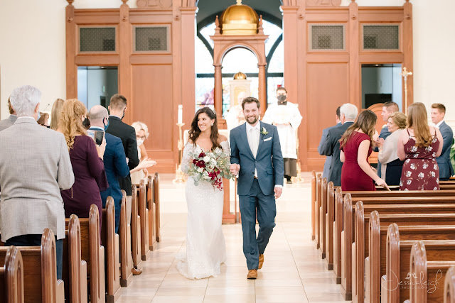bride and groom leaving church ceremony