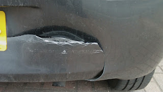 damaged driving instructor car bumper