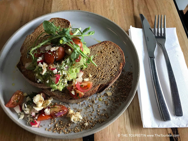 Decorated Avocado on sourdough  on a grey breakfast plate