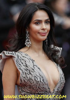"""Name : Reema Lamba. Nick Name : Mallika. Showbiz Name : Mallika Sherawat. Profession : Actress, Model. Date Of Birth : 24 October 1976. Age in 2019 : 43 Years Zodiac Sign : Scorpio. Birth Place : Rohtak, Haryana, India. Home Town : Moth, Haryana, India. Nationality : Indian. Religion : Hinduism. Address : Mumbai. Father : Mukesh Kumar Lamba. Mother : Santosh Sherawat. Brother : Vikram Lamba. BODY STATISTICS:  Height : 5 Feet & 6 Inches. Weight : 52 Kg / 115 Lbs. Eye Colour : Brown. Hair Colour : Black. Figure : 36(Chest) - 26(Waist) - 36(Hips). Body Type : Slim. Shoe Size : 10. EDUCATION:  Schooling : Delhi Public School, New Delhi. College : Delhi University.  Degree : Graduate in Philosophy.  BOLLYWOOD DEBUT:  Jeena Sirf Mere liye. (2002). TV DEBUT:   The Bachelorette India (2013). HOBBIES:   Travelling. Doing Yoga. Watching movies. FAVOURITES:  Actor : Amitabh Bachchan. Actress : Kareena Kapoor Khan. Food : Desi Food. Colour: White. Film : Underground. BOYFRIEND:   Cyrille Auxenfans. MARITAL STATUS:  Divorced. HUSBAND:  Karan Singh Gill.(2000 - 2001). SALARY:  05 Crore For a Film (Approx). MORE:   Mallika Sherawat's original name was Reema Lamba, but after entering to the Showbiz World she changed her name to Mallika Sherawat following her mother's name. Mallika before entering Showbiz did worked as an Air Hostess. She got recognised after her film titled """"Khwahish"""" in which she did 17 kisses.     Mallika Sherawat is known for her Bold attitude, and is known for her item Songs as well. She has been offered many nude scenes and films as well but she refused. (but also did many of them in Bollywood Movies). She met many presidents / prime ministers and many of them appreciated her work."""