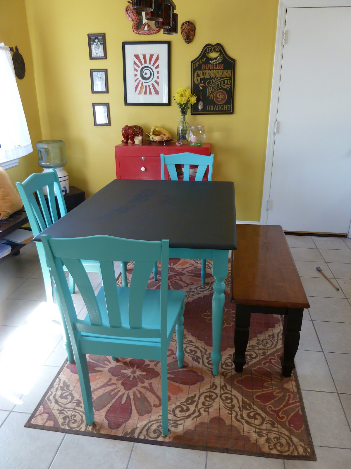 dal kitchen rehab and table art painting kitchen table First we sanded down the old veneer lightly with sandpaper a tedious process and then painted on several coats of a shiny happy turquoise