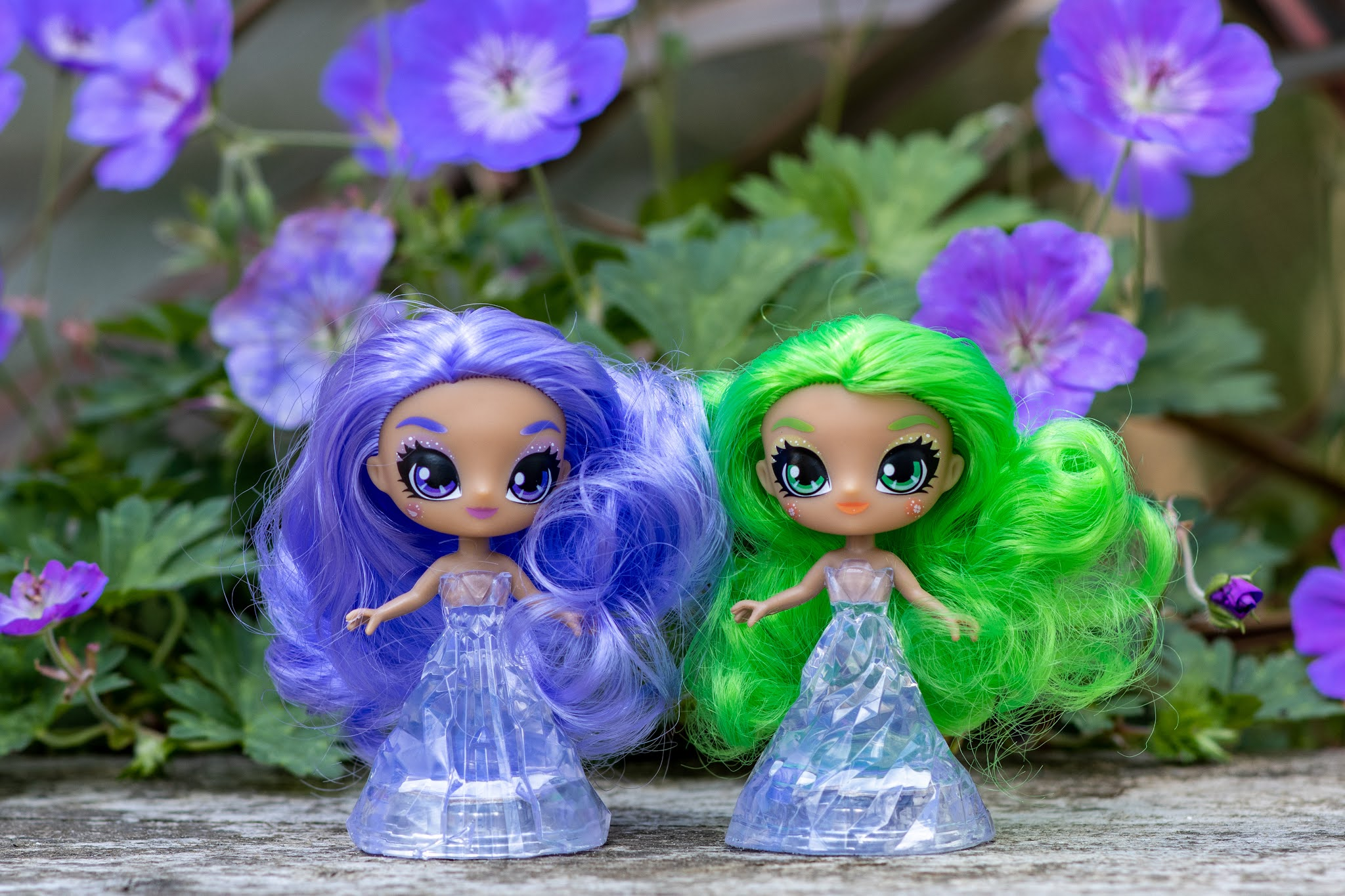 Purple haired amethyst and green haired adventurine crystalina sprite dolls next to each other