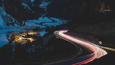 Long exposure, night, road, houses, mountain, snow