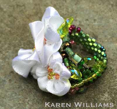 side view of Karen Williams' Apple Blossom freeform peyote ring