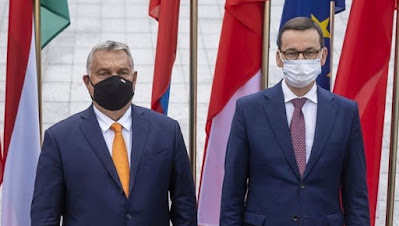 la levée des vétos de la Pologne et de la Hongrie.