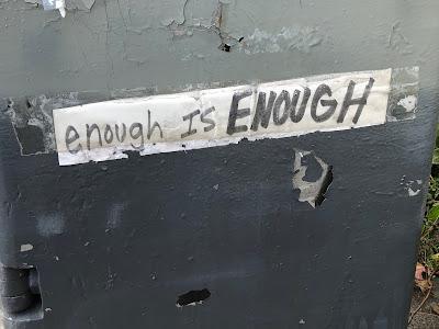 """Sticker saying, """"enough is ENOUGH"""""""