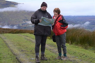 Guide with customer on hill walk Leitrim