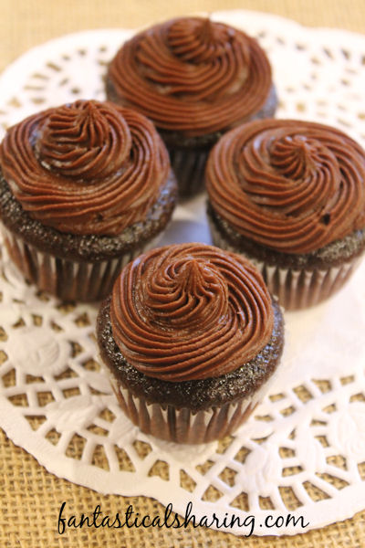 Mini Chocolate Ganache Cupcakes // These bite-size cupcakes are deliciously full of rich chocolate #recipe #cupcakes #chocolate #Choctoberfest #dessert