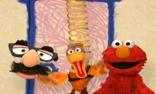 Elmo and Groucho Marx Glasses play a game. when Elmo says the secret word, a duck springs down from the ceiling and bounces in on a spring. Elmo's World Eyes Interview
