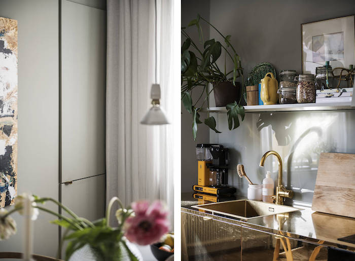 Cocina diáfana con paredes pintadas , muebles de latón y grifos dorados
