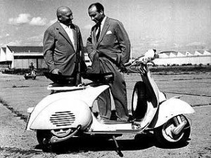D'Ascanio (left) and Enrico Piaggio with the Vespa scooter that made both their names