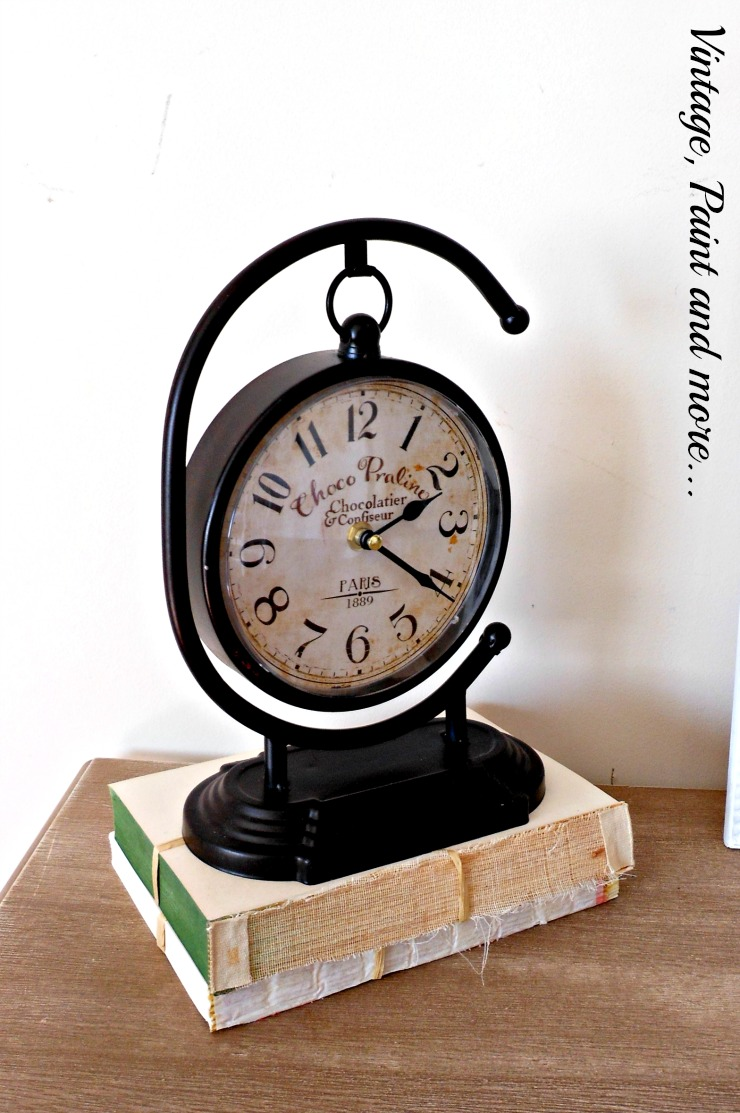 "a ""vintage"" clock, old paper books tied with twine, vintage Valentine vignette"
