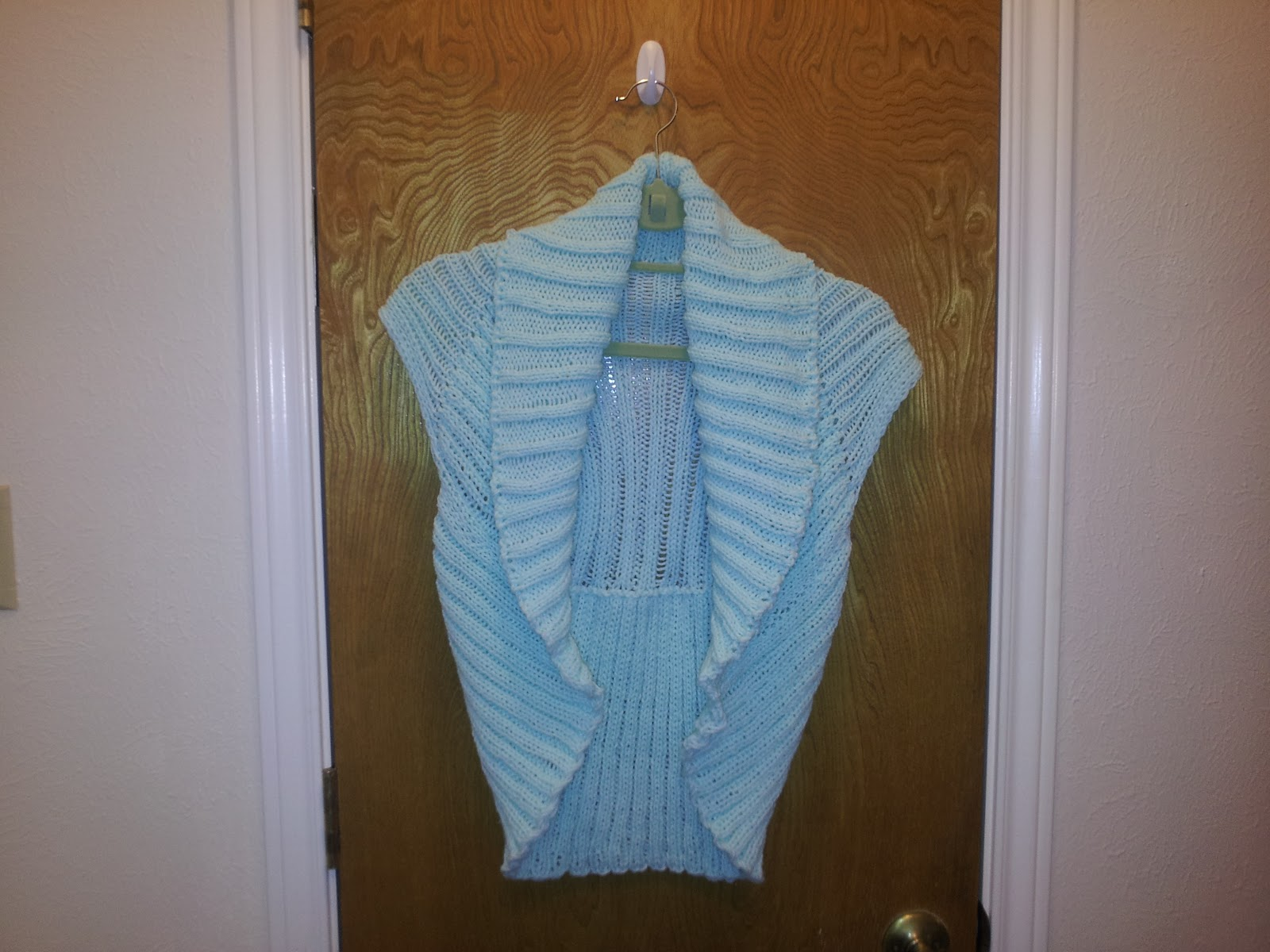 5d2fa19e376cad The vest is knit in a one piece (sort of) rectangle