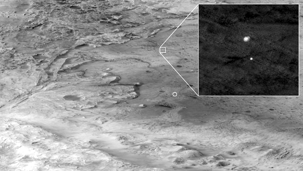 NASA's Perseverance rover--still encased inside its aeroshell and under a parachute while approaching its landing site at Mars' Jezero Crater--as seen by the Mars Reconnaissance Orbiter 700 kilometers (435 miles) away in space...on February 18, 2021.