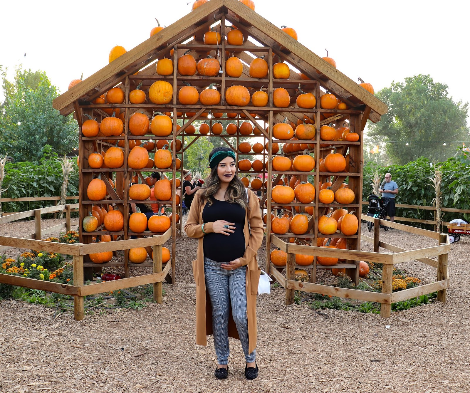Fall Pumpking patch outfit with long camel cardigan and plaid leggings