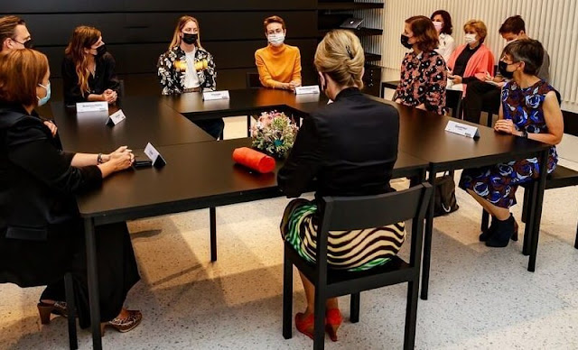 Queen Mathilde wore a skirt and blouse by Dries Van Noten of Spring Summer 2021 collection. Delphine Nardin gold earrings