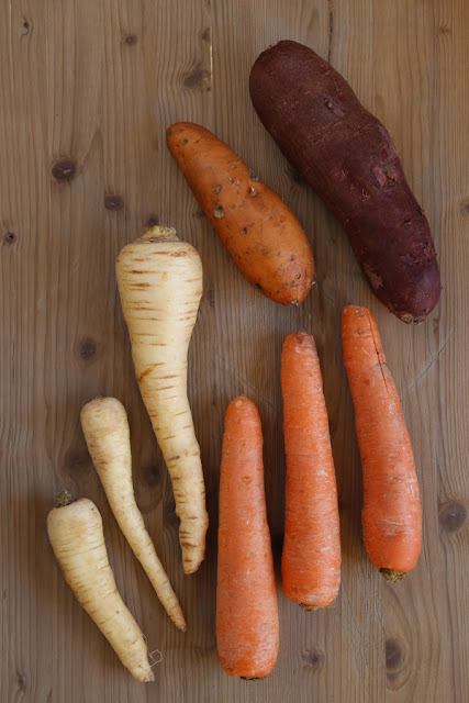 Parsnips, Carrots and Sweet Potatoes on a wooden background
