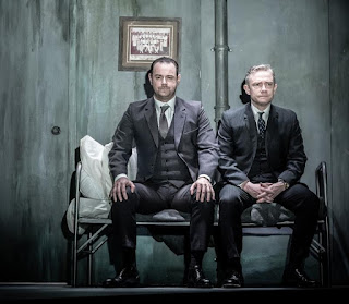 Danny Dyer sitting on stage in a Pinter play