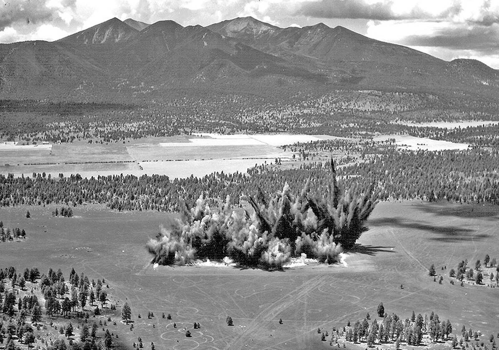 Explosions send dirt into the sky during the construction of Cinder Lake Crater Field #2 on July 27, 1968. A total of 354 craters were carved out of the Arizona landscape in this field to create a simulated lunar surface.
