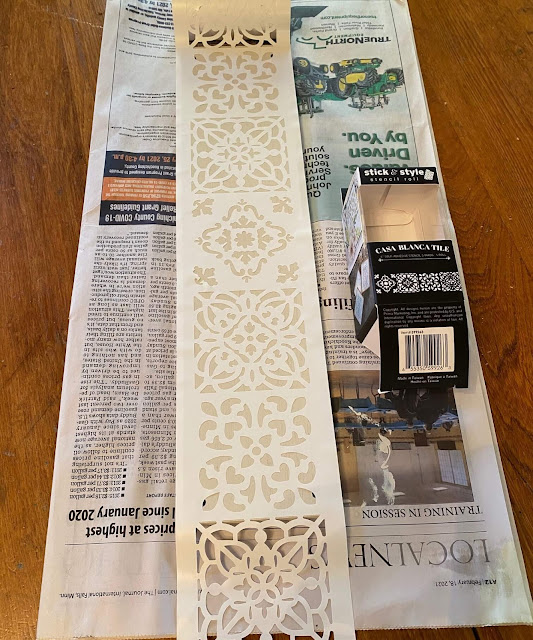 Photo of adhesive stencil roll adhered to painted board