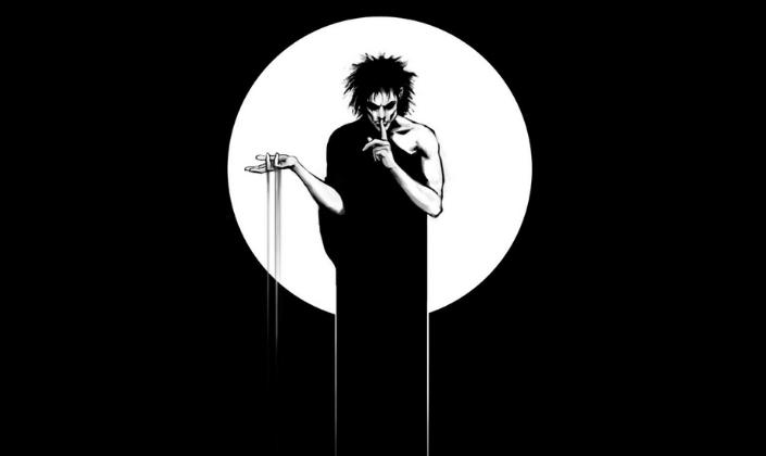 Imagem da capa: fundo preto com a ilustração de Morfeus, uma figura masculina muito pálida, envolta num manto negro e com cabelos negros muito longos e bagunçados, erguendo uma mão com areia escorrendo dela e levando com a outra o dedo aos lábios em sinal de silêncio e um círculo branco por trás.