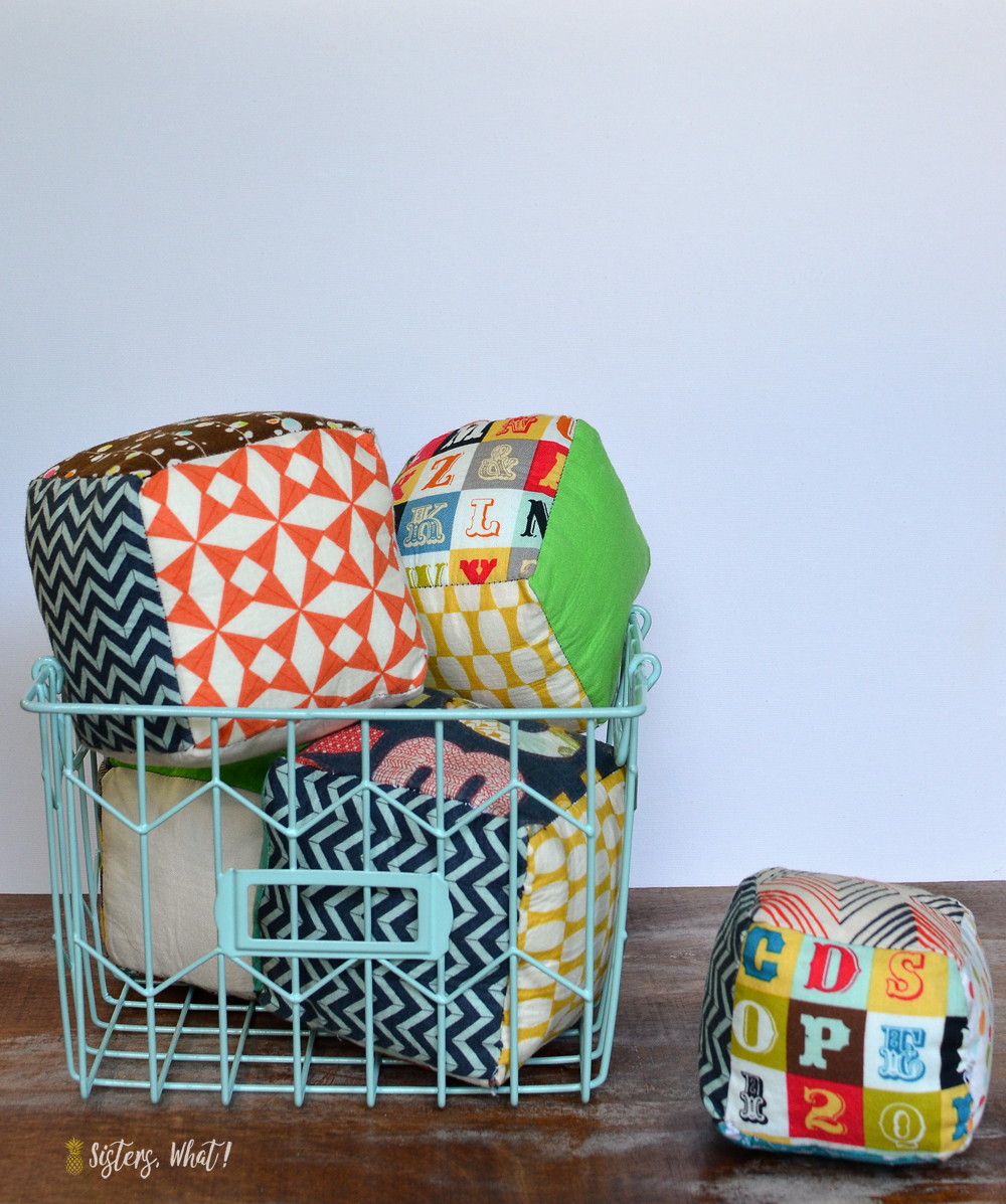 fun play fabric cubes  that can be made out of fabric scraps; a fun sewing tutorial
