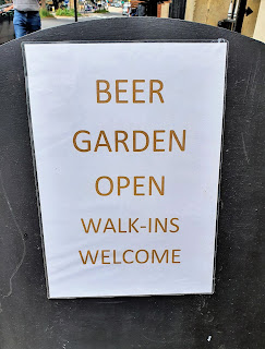 Photo of a sign saying: Beer Garden open. Walk-ins welcome