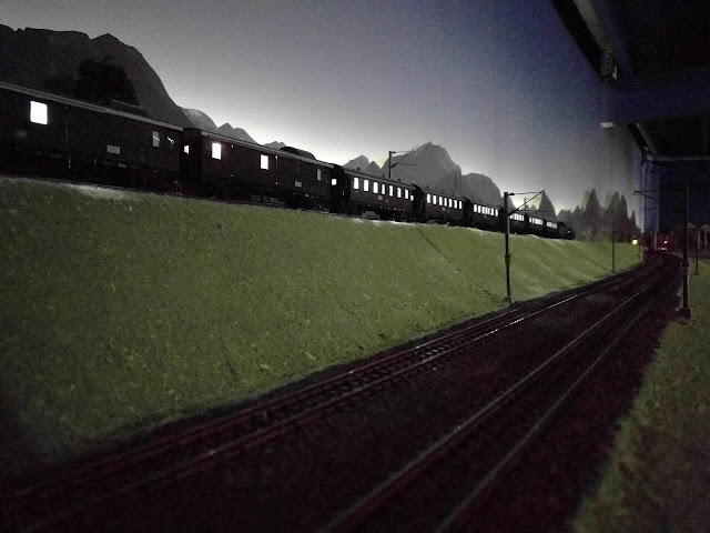 model train illuminated at night